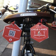 Saddle tags designed by the Generation Zero team for the #KRDCYCLELANES campaign as affixed to my bike