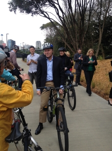 The Prime Minister, John Key, riding with the Mayor, Len Brown.